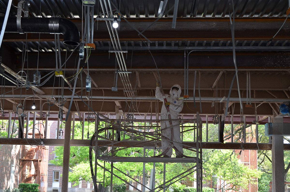 Calmar spray foam technician at work in commercial building